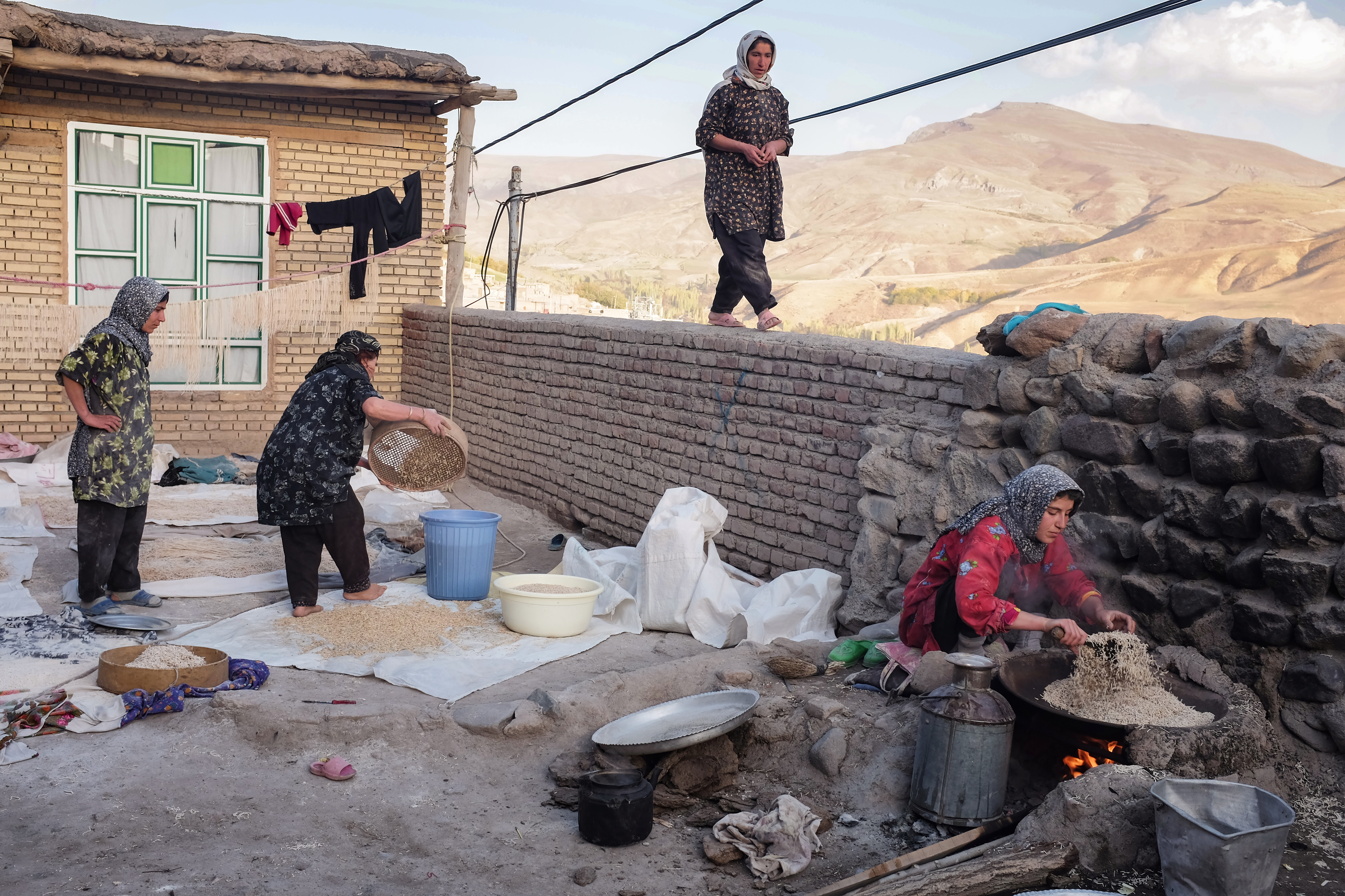 The courtyard outside the house. Roghayyeh and the other women in the family are making provisions for the coming winter months. Ajabshir, East Azerbaijan, Iran.