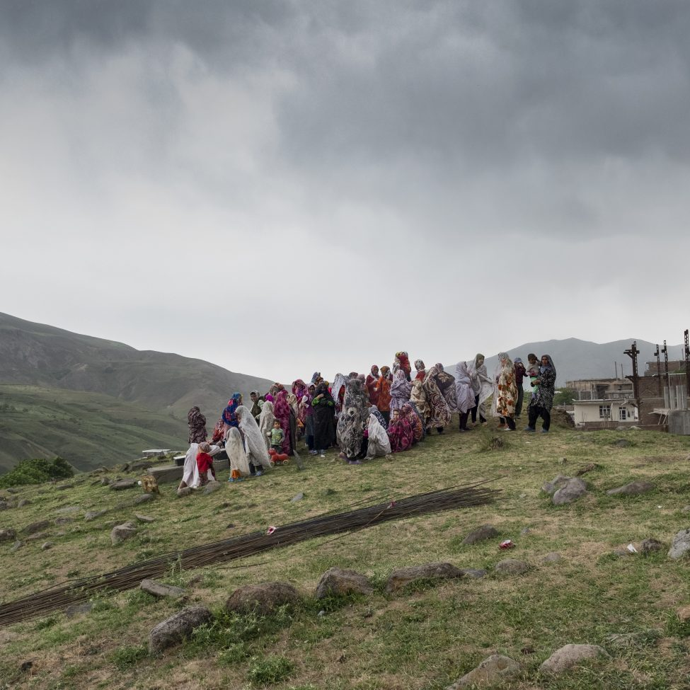 Women of the extended family sharing food during a ceremony in the local cemetery to commemorate the death of Roghayyeh's brother. Ajabshir, East Azerbaijan, Iran.