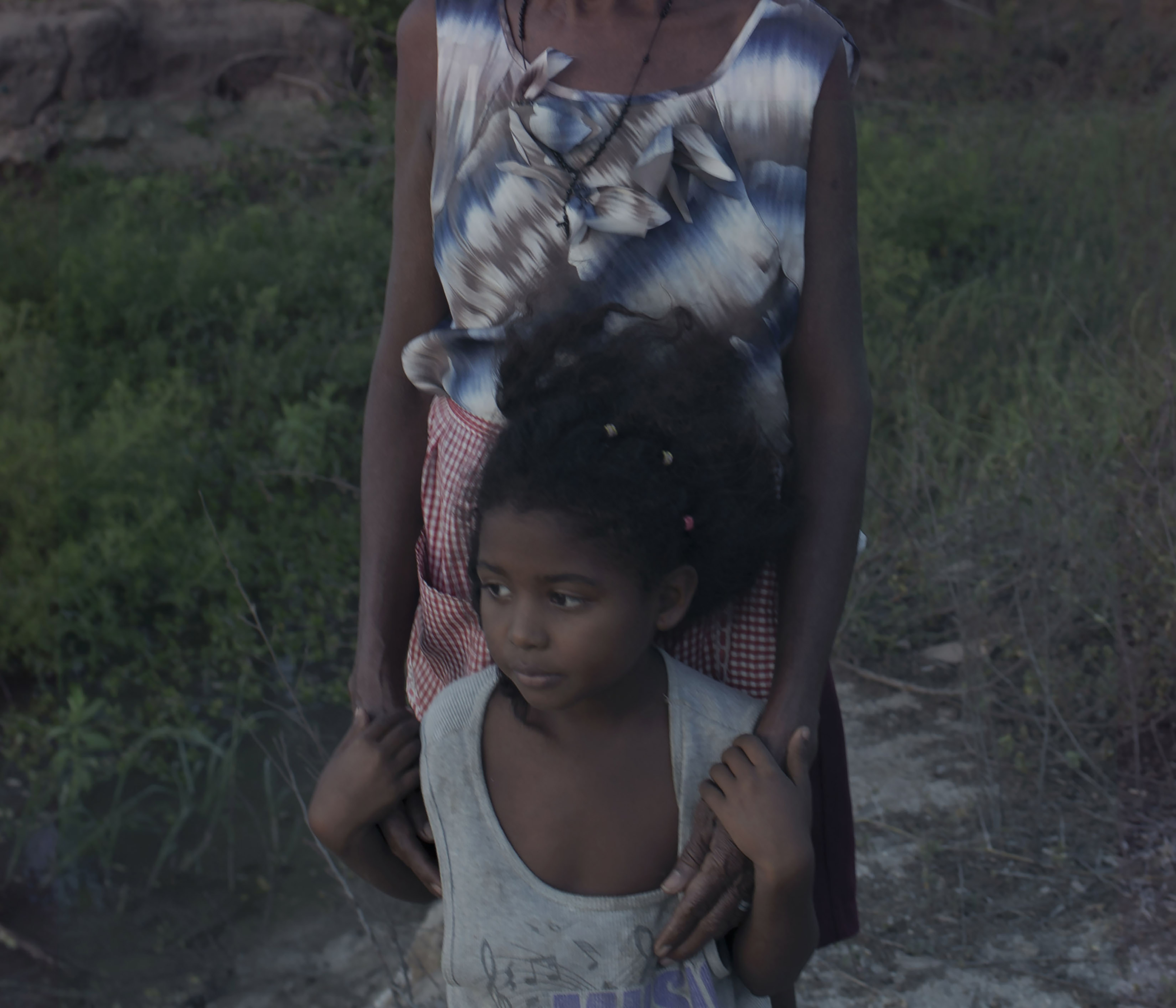 Mitchel clings to Nicolasa, her grandmother.  Family is the center of most peoples life here and many who are born in El Azufre never leaves.