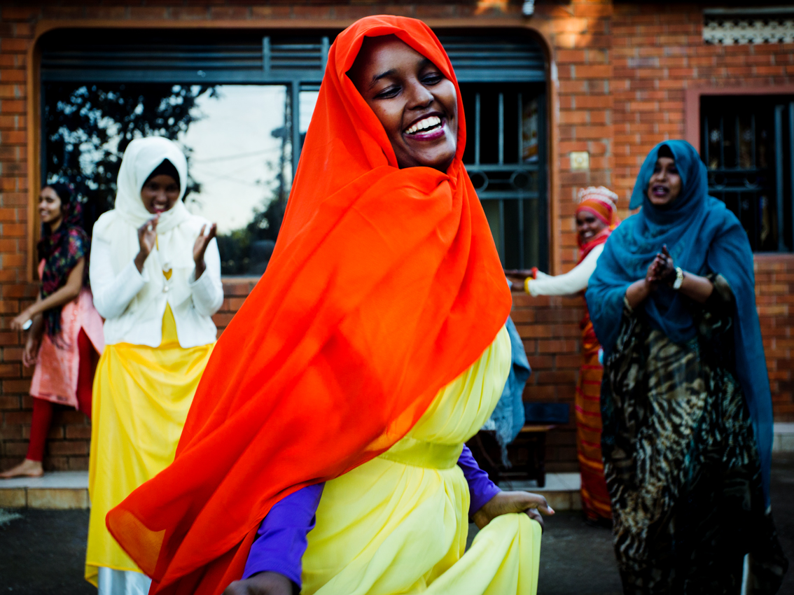 During a traditional Somali wedding in Kampala, a young married woman is seen dancing with other females. Despite the struggles of exile there is always room for moments of joy.