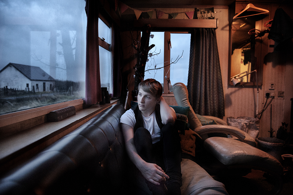 Connor Clarke, 18years old, Island of lewis, January 2016. he lives in a caravan with his parents for two years, while waiting their house is being finished. This year he will finish high school and leave to Glasgow. Two years ago, Connor did is coming out, facing courageously some prejudices of his very conservative community. He wants to become an actor and above all he wants to leave the island. Here he feels like in a cage , locked in a world too small for him , even if his friends and family are very important. He knows he needs to go. The city Glasgow will provides him the anonymity, its folly and its fantasies.