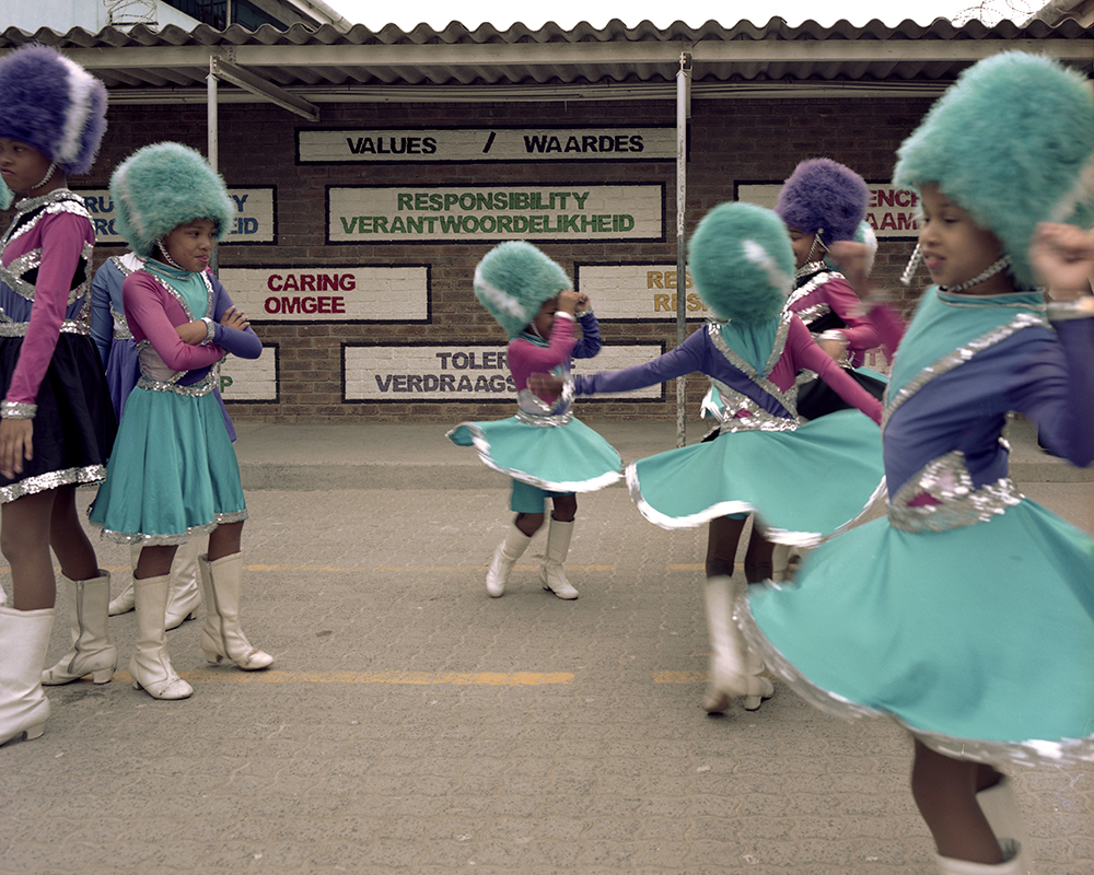 The drum majorettes before practice, in one of the school quads.