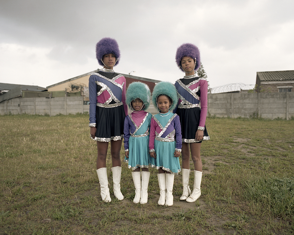Themeline Mentoor, Amber Matthews, Ra'eesha Maneveldt and Keashar Malgas. On one of the schools outer fields, sometimes used for drill practice.