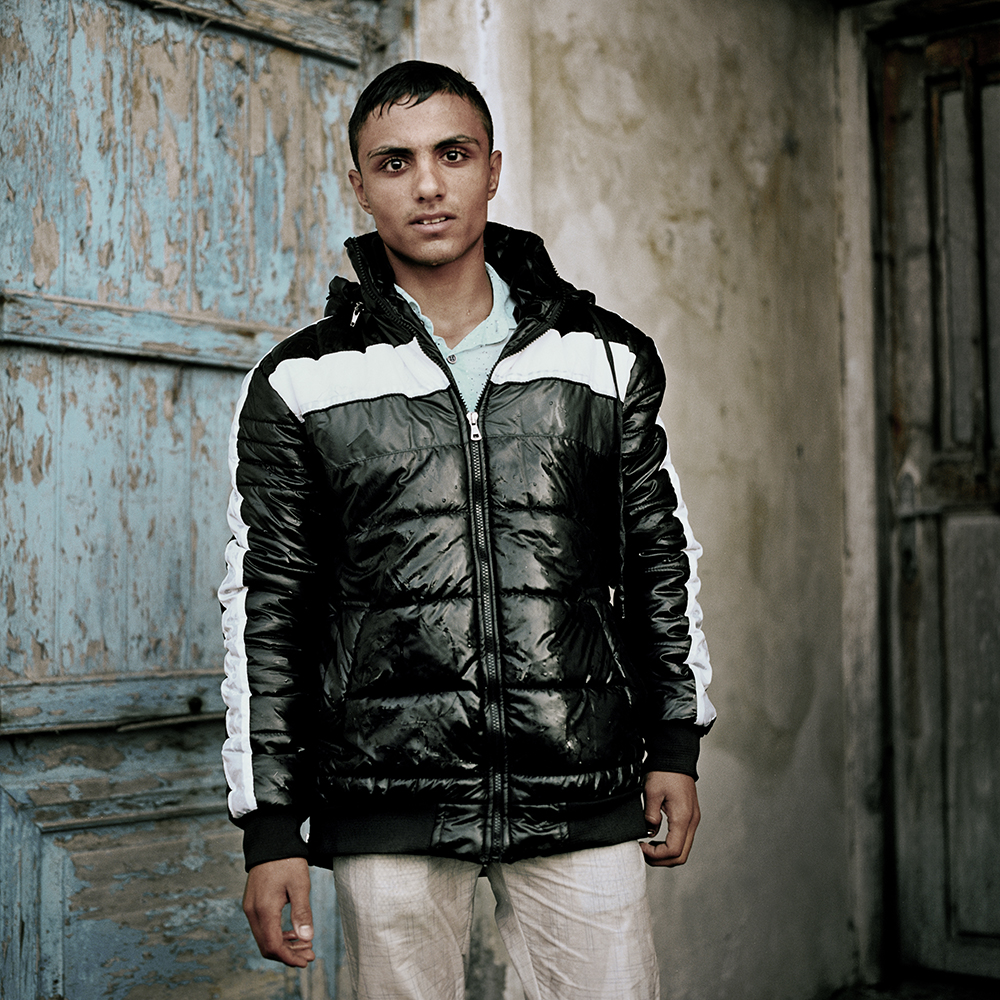 Mohammed in drenched clothes, poses for a portrait after disembarking on Lesvos island. He fled the war in Syria and says he will continue towards Germany where he hopes to find a good life and treatment for his diabetes. esvos, Greece. October 2015