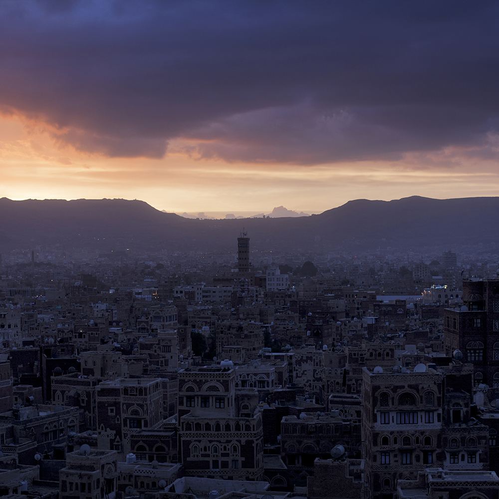 View over Sana'a Old City at dusk in Yemen.